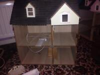 2 dolls houses both cost £200 each