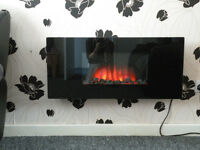Black wall mounted electric fire with remote control