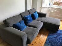 L shaped charcoal sofa