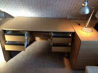 Desk - oak finish, 1375 mm long, 750mm wide, 740mm high. Four drawers. Easy to assemble.