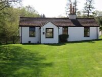 Holiday cottages in quiet spot in Scottish Highlands high up overlooking Cairngorm Mountains