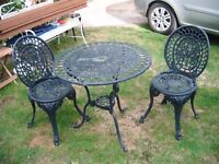 Cast Aluminium table and four chairs navy used