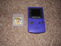GAMEBOY COLOUR WITH POKEMON GOLD AND RED AND MARIO