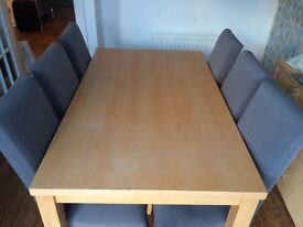 Dining table with 6 chairs and sideboard