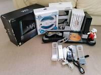 Nintendo Wii black + 8 games inc mario kart & sports resort + balance board