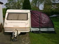 4 berth caravan with awning.