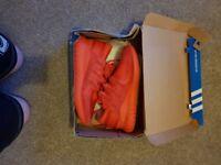 Red Adidas tubular