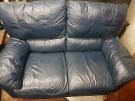 Blue leather two seater sofa. FREE delivery in Derby