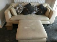 Cream fabric sofa and large foot stool