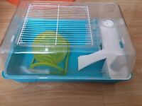 Hamster cage with bedding and everything else