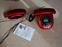 Retro red home static phone with answering phone and additional portable handset