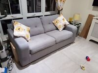 Grey two seater sofa with armchair