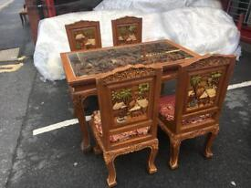 Hand carved table and chairs