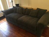 Large fabric sofa in blue fabric with scatter cushions