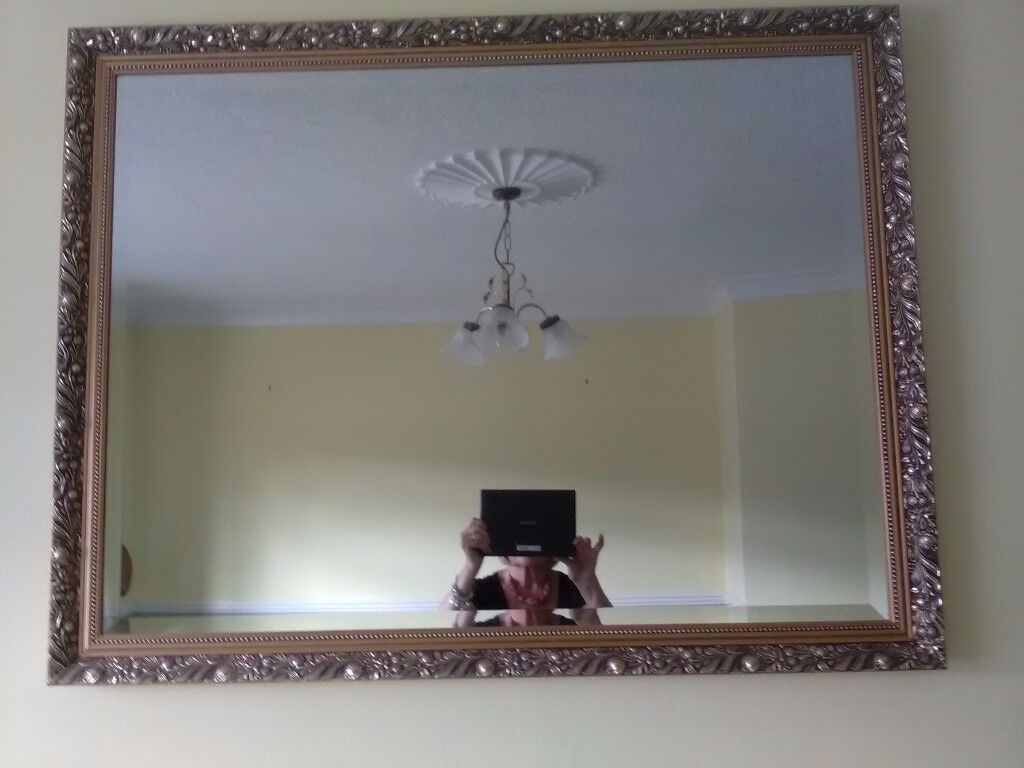 LARGE GILT OVER MANTLE MIRROR.