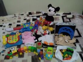 Toys bundle Mickey Mouse gitar,story teller,phone,wooden train set,hand puppets,e.t.c