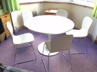 White round table and five white leather and chrome chairs