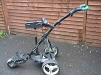 Powerbug electric golf trolley with lithium battery and charger and golf seat with lid compartment.