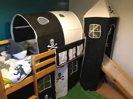 Children's mid sleeper bed with pirate canopy and slide
