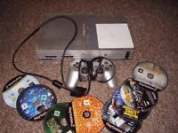 PLAYSTATION 2 SILVER WITH GAMES