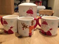 Christmas mugs and biscuit jar