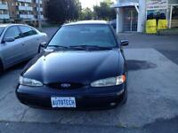1996 Contour Fast  V6 5 speed  with snows , leather seats