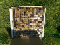 Unused shiny brown bathroom mosaic tiles
