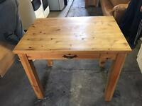 Nice pine table with drawer can deliver