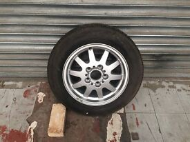 bmw alloy wheel with new bridgestone tyre 205/60/15 never been on car bargain £25