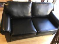 Black leather look sofa