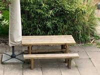 Garden wooden table with two benches