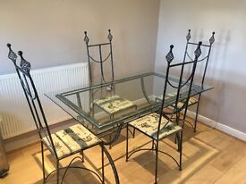 Brushed silver metal table with glass top and four matching chairs