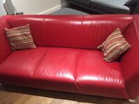 Red leather DFS suite. Sofa, arm chair and stool.