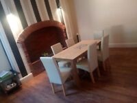 Dinning room table with 6 cream leather chairs