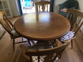 Antique pine circular dining table and 4 chairs (2 carvers, 2 matching)