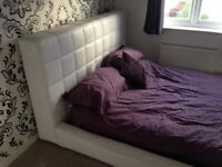 Réal leather king size bed with temper mattress.