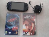 psp and charger plus 3 games