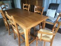 Dining table (extendable) plus 8 chairs in polished French Oak.
