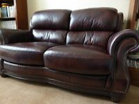 Lovely dark brown leather sofa and pouffe - very good condition; animal-free home, hardly used.