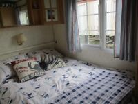 Static caravan on lovely site in Oxwich Bay. Two beds, one en suite, sleeps six, central heating
