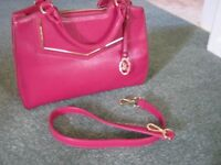 A Jane Stilton handbag with two inside pockets which one is zipped and comes with a clip on strap.