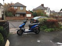 Beautiful Blue Black Moped . New - only 14 miles on the clock