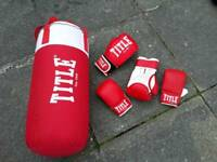 Punch bag and gloves.