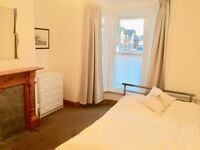 large room in a friendly shared house. High speed WIFI. No FEES. Suit young prof.