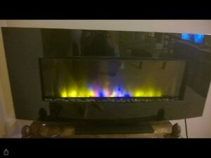 Electric fireplace with a remote