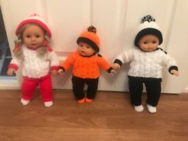 Dolls with hand knitted outfits