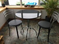 Black Marble round dinning table with 2 matching leather seats!