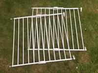 Two Lindam adjustable stair gates