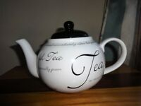 Teapot like new. Black and white script design. Excellent condition as barely used.