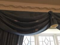 Professionally made curtains for a large window in a beautiful blue. Excellent condition. £50